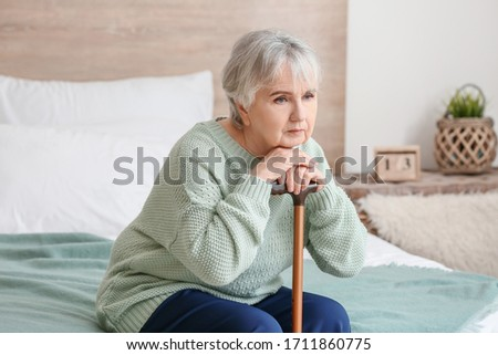 Elderly woman suffering from mental disability at home #1711860775