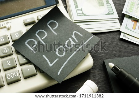 Memo sign PPP Loan Paycheck Protection Program on the black piece of paper. Royalty-Free Stock Photo #1711911382