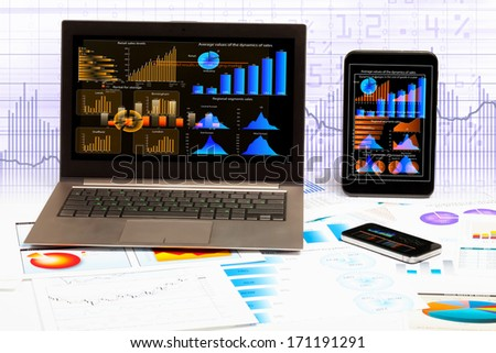 Image of ipad laptop and mobile phone with diagrams illustration
