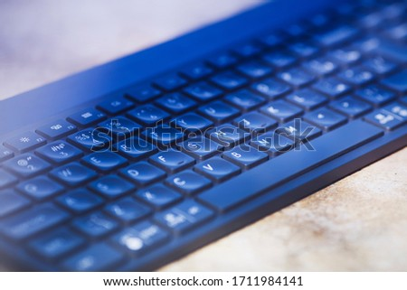 Close up detail view of computer keyboard. Remote work, business, office concept. Top view. Space for a text. #1711984141