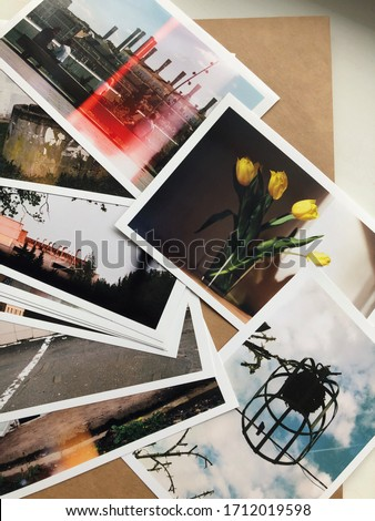 Stack of printed color photographs