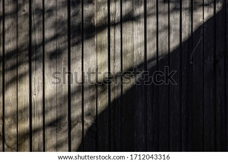Wooden fence in the shade of trees #1712043316