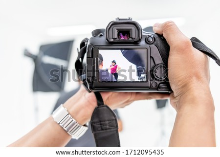Close up images of photographers are shooting Asian fat women in the studio with lighting equipment, To get a perfact and beautiful image, to the work of a professional photographer concept. #1712095435
