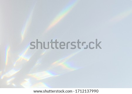 Blurred overlay effect for photo and mockups. Wall texture with organic drop diagonal shadow and rays of light on a white wall. shadows for natural light effects #1712137990