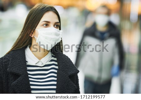 woman with protective face mask at public place. corona virus outbreak #1712199577