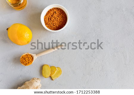 On a white background is a set of products for making drinks to support the immune system and prevent diseases lemon, turmeric, honey, ginger.Herbal medicine an anti-inflammatory. Copy space, flat lay #1712253388