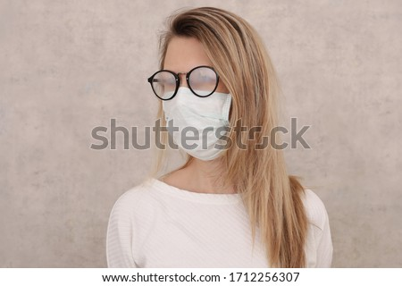 Medical mask and Glasses fogging. Coronavirus prevention, Protection. New habits during Self-isolation , Quarantine Royalty-Free Stock Photo #1712256307