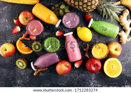 Assortment of fruit smoothies in glass bottles. Fresh organic Smoothie ingredients. Smoothies for health or detox diet food concept. #1712283274