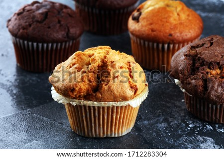 Chocolate muffin and nut muffin, homemade bakery on table at home #1712283304