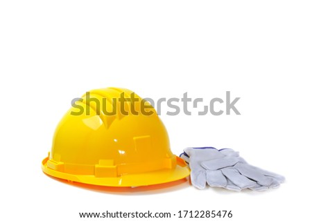 yellow helmet and leather gloves for work environments