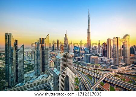 Dubai - modern and luxury city skyline at sunrise, United Arab Emirates Royalty-Free Stock Photo #1712317033
