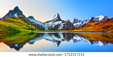 Sunrise view on Bernese range above Bachalpsee lake. Peaks Eiger, Jungfrau, Faulhorn in famous location in Switzerland alps, Grindelwald valley Royalty-Free Stock Photo #1712317153