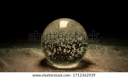A pic of a grey blue magic ball