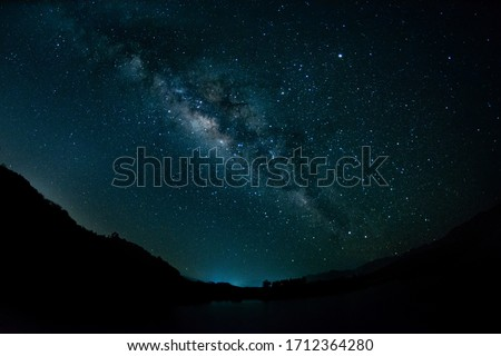 Backgrounds night sky with stars and milky way at thailand