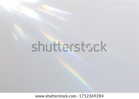 Blurred overlay effect for photo and mockups. Wall texture with organic drop diagonal shadow and rays of light on a white wall. shadows for natural light effects #1712369284