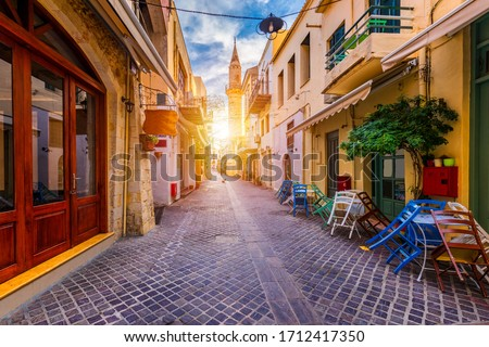 Street in the old town of Chania, Crete, Greece. Charming streets of Greek islands, Crete. Beautiful street in Chania, Crete island, Greece. Summer landscape. Chania old street of Crete island Greece. #1712417350