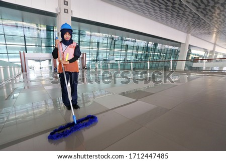 Tangerang, West Java / Indonesia : July 2, 2016 : Cleaning services at Terminal 3 Ultimate Soekarno Hatta Airport #1712447485
