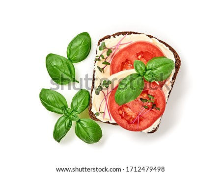 Open sandwich tomato, mozzarella, soft cheese, basil. Homemade vegan sandwich with rye bread, microgreen isolated on white, top view. Healthy eating, diet tomato sandwich closeup #1712479498