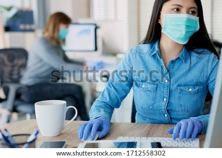 Woman in protective gloves and mask in the office #1712558302