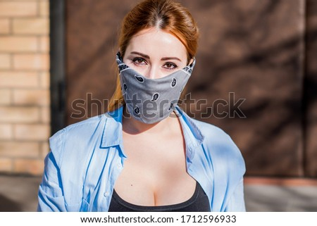 Young woman in fashionable homemade mask, scarf on her face, stop virus, save yourself, modern lifestyle #1712596933
