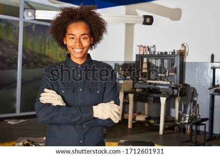 African woman in teaching to mechanic or automotive mechatronics in workshop #1712601931