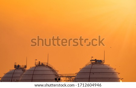 Industrial gas storage tank. LNG or liquefied natural gas storage tank. Spherical gas tank in petroleum refinery. Above-ground storage tank. Natural gas storage industry and global market consumption  #1712604946