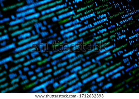 Dark blue monitor with programming code. Technology abstract background. Bokeh hacker and development concept.