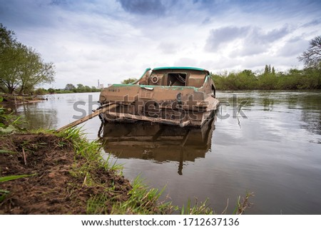 Small river boat sunk example #1712637136