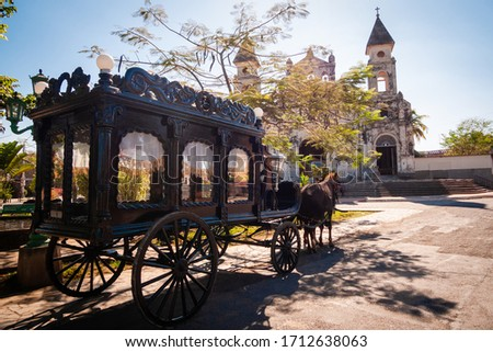 Funeral carriage with horse in front of old church, old horse carriage to carry coffins Royalty-Free Stock Photo #1712638063