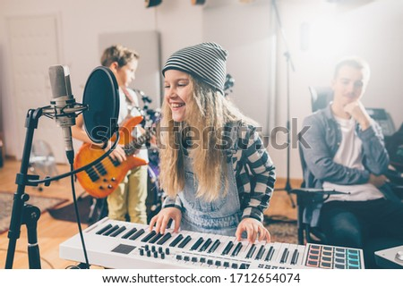 kids rock band practice in music studio Royalty-Free Stock Photo #1712654074