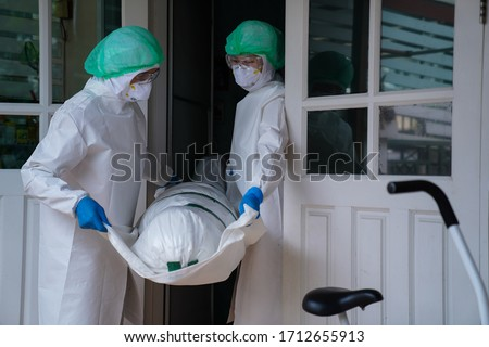 COVID-19 DEAD: Death increases every day. Staff wrapped up the dead bodies of Coronavirus covid-19 infection Royalty-Free Stock Photo #1712655913