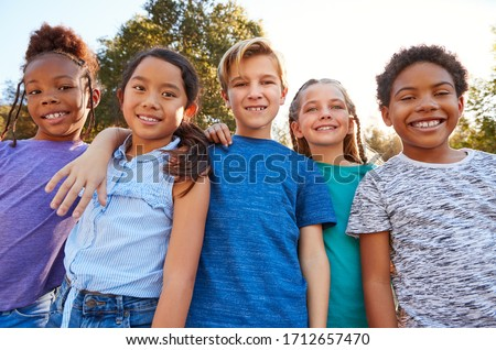 Portrait Of Multi-Cultural Children Hanging Out With Friends In Countryside Together #1712657470