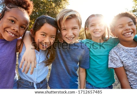 Portrait Of Multi-Cultural Children Hanging Out With Friends In Countryside Together #1712657485