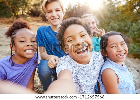 POV Shot Of Multi-Cultural Children Posing For Selfie With Friends In Countryside Together #1712657566