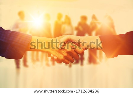 Close up people hands shake business partnership success,Shake hand concept #1712684236