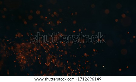 Fire sparks isolated on black background #1712696149