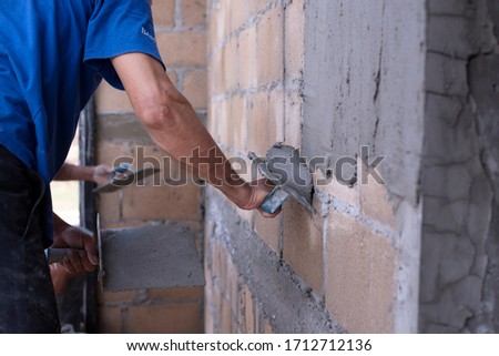 Plastering of plaster workers on the walls for building houses, repairing plaster, indoor walls and ceilings with floating and plastering #1712712136