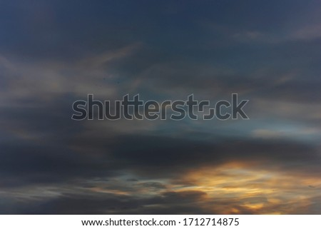 Spring evening sky in the picturesque clouds, lit by the rays of the setting sun. #1712714875