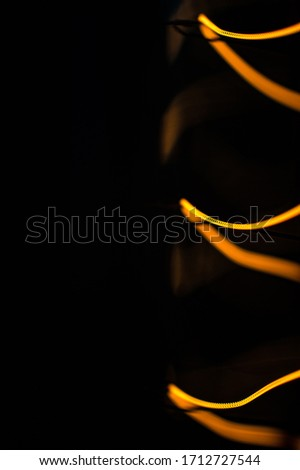 Macro shot of glowing wire of edison lamp on black background with copy space #1712727544