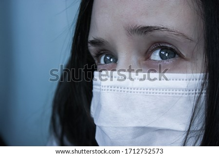 Girl in a medical mask during the COVID-19 epidemic #1712752573