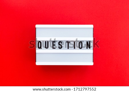 Message Question on white lightbox isolated on red background. Business and education concept, yes or no