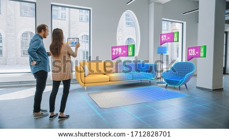 Decorating Apartment: Lovely Young Couple Use Digital Tablet with Augmented Reality Interior Design Software to Choose 3D Furniture for their Home. Furniture from Online Shop with Prices. #1712828701