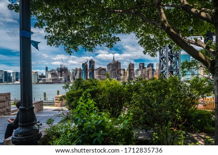 New York City from Long Island City where you can see the Manhattan skyling, main eastside building including united nation building #1712835736