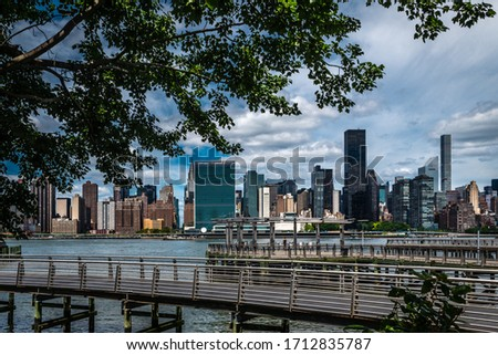New York City from Long Island City where you can see the Manhattan skyling, main eastside building including united nation building #1712835787