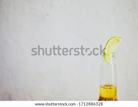 Fresh beautiful Mexican beer with lime piece. Space for copy. Cinco de Mayo holiday. #1712886328