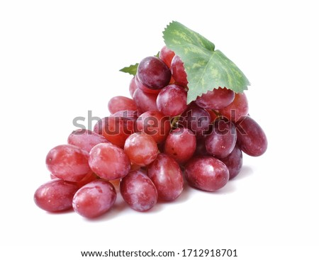 Red grapes with green leaves, large bunch of fruits on a white background #1712918701