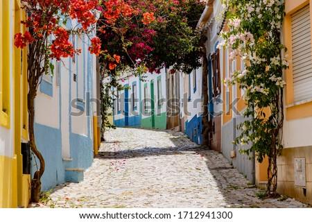 On the narrow Alleys of Ferragudo, Algarve, Portugal, Europe Royalty-Free Stock Photo #1712941300