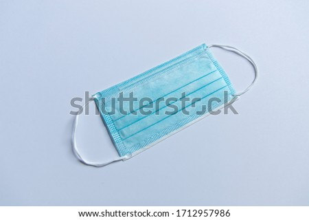 Close-up shot of a surgical respiratory mask against corona virus covid-19 infection, resting on a backdrop. #1712957986
