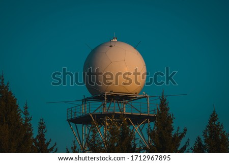 Detail view of a rain radar or meteorological doppler radar for measuring precipitation in early morning hours during sunrise on Pasja Ravan hill in Slovenia Royalty-Free Stock Photo #1712967895