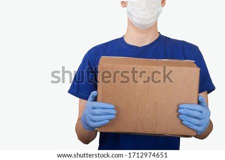 Smiling man holding donation box on white background #1712974651
